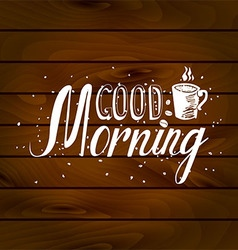 Good morning inscription on wooden background vector
