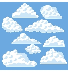 Cartoon clouds on the blue sky vector