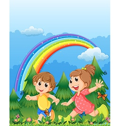 Kids playing near the garden with a rainbow in the vector image vector image