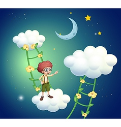 A boy standing above the clouds vector