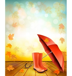 Autumn background with umbrella and rain boots vector image