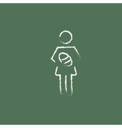 Woman holding the baby icon drawn in chalk vector