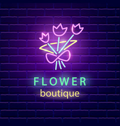 Flower boutique neon emblem vector