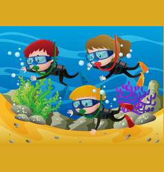 three kids scuba diving under the sea vector image vector image