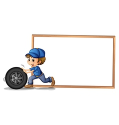A boy pushing a wheel with an empty blankboard at vector image