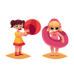 two girls playing on beach with inflatable ring vector image