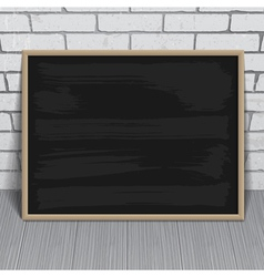 Black chalkboard with wooden frame on brick wall vector