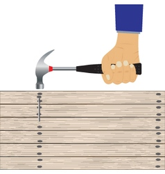 Hand with a hammer and wooden board vector