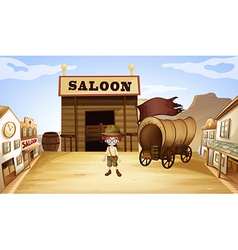 A young boy in front of a saloon bar vector image
