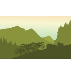 Silhouette of house in hills vector