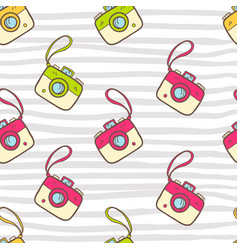 Seamless summer pattern with color photo camera vector