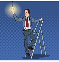 Pop Art Businessman with Ladder and Lightbulb vector image vector image