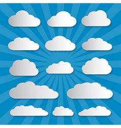 Clouds cut from paper on blue background vector
