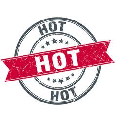 Hot red round grunge vintage ribbon stamp vector