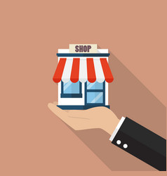 businessman hand holding a shop store vector image