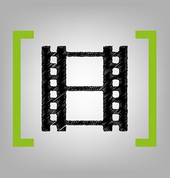 Reel of film sign black scribble icon in vector