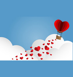 red paper hearts falling from hot air balloon vector image