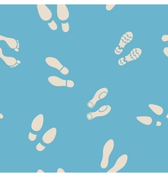 Seamless background with footprints and shoeprint vector