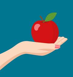 Woman hand holding an apple vector
