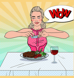 Woman taking photo of food in restaurant pop art vector