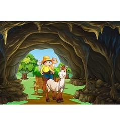 Man riding wagon through the cave vector
