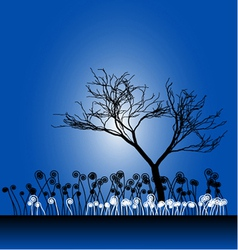 Tree silhouette with the grass vector image