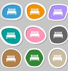 Hotel bed icon sign Multicolored paper stickers vector image