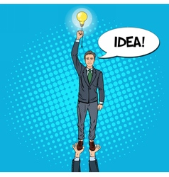 Pop art businessman with lightbulb team work vector