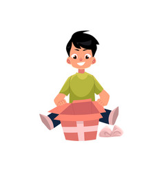 cartoon boy opening present box isolated vector image