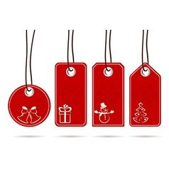 Set of hanging red tags with christmas motifs vector