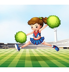 A cheerdancer with green pompoms at the soccer vector image