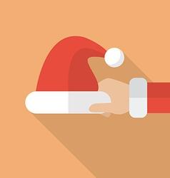 Santa hand holding Santa hat vector image vector image