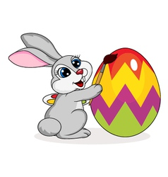 Cute rabbit painting an Easter egg vector image