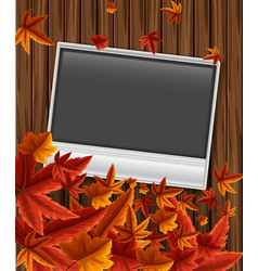 Photoframe on wooden board with leaves vector