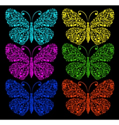 Butterflies on a black background vector