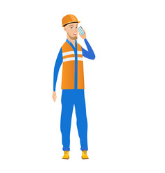 Young caucasian builder talking on a mobile phone vector