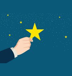 Businessman hand picking up a star vector