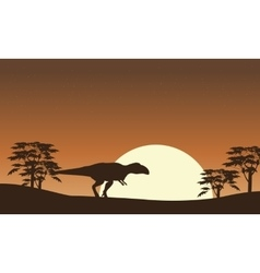 Silhouette of mapusaurus with tree scenery vector image