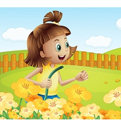 A girl watering the plants in the garden vector