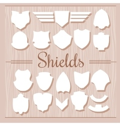 Shields Set on wooden background vector image