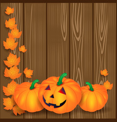 halloween with pumpkins and leaves on wooden vector image vector image