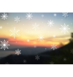 Abstract snowflakes on blurred sunset vector image