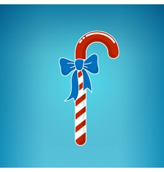 Christmas Candy with Bow on a Blue Background vector image