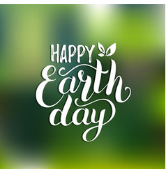 Happy earth day hand lettering card on blurred vector