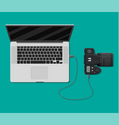 photo camera plugged to laptop usb port vector image