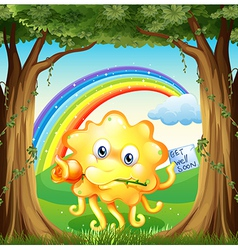 A monster with a get-well-soon card and a rainbow vector image vector image