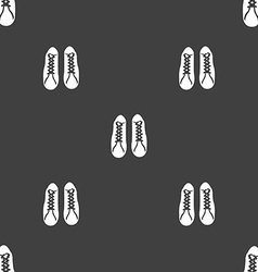 Shoes icon sign seamless pattern on a gray vector