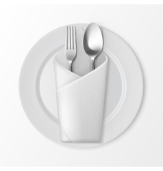 Plate with silver fork and spoon table setting vector