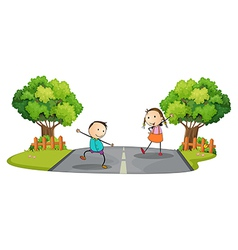 Two kids playing at the street vector image