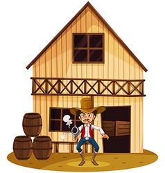 A man holding a gun near the barrels vector image